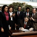 Without Corretta there would be no Ronald Reagan signs the bill making Martin ...