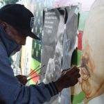 Today I took a photograph of a man painting a portrait of MLK on MLK Day at the …