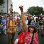 Joyce Elliotte of Temple Hills, Md., joins thousands of people as they march fro...